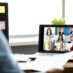 Woman talking with international colleagues using online video chat service